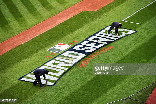 Members of the Cleveland Indians grounds crew paint the World Series logo on the field prior to Media Day at Progressive Field on October 24 2016 in...