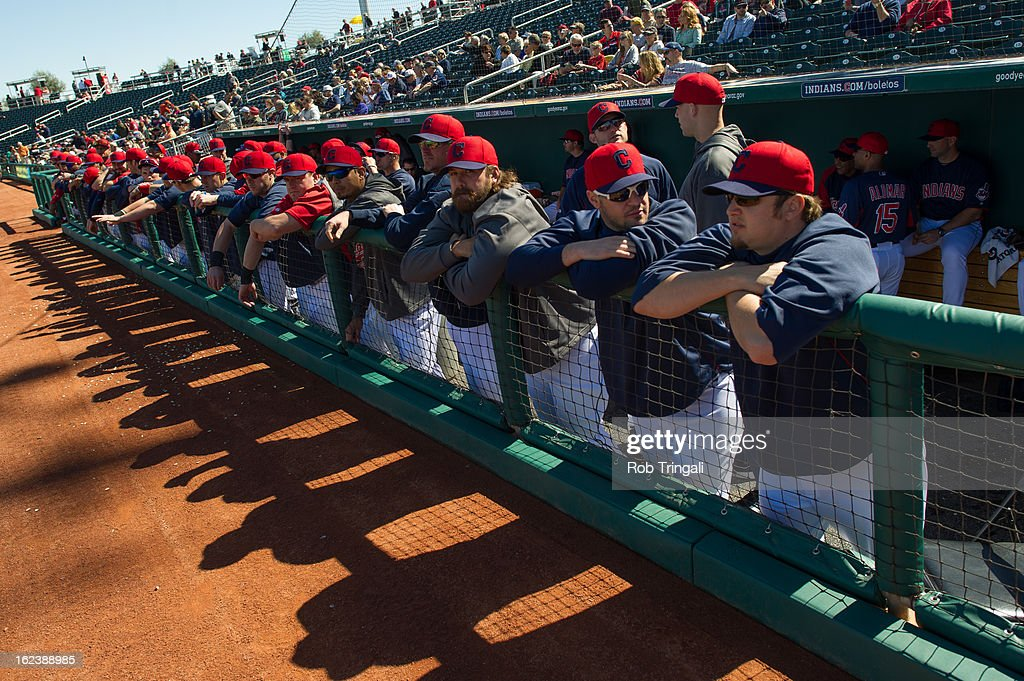Members of the Cleveland Indians look on from the dugout before the game Cincinnati Reds at Goodyear Ballpark on February 22, 2013 in Goodyear, Arizona.