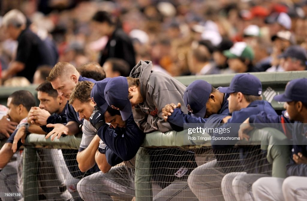 Members of the Cleveland Indians look on from the dugout dejected against the Boston Red Sox during game seven of the American League Championship Series on October 21, 2007 at Fenway Park in Boston, Massachusetts