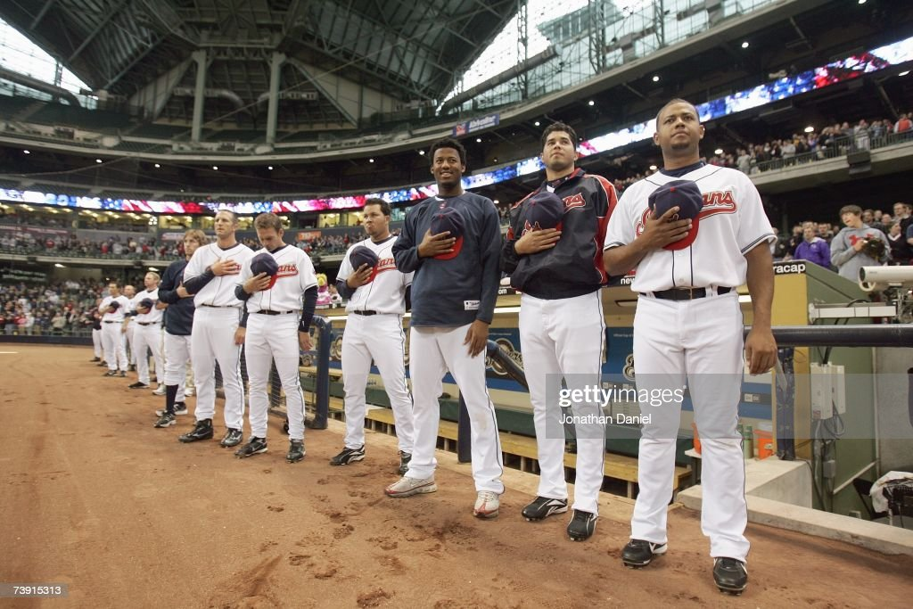 Members of the Cleveland Indians stand under the roof during the National Anthem before a home game against the Los Angeles Angels of Anaheim on...