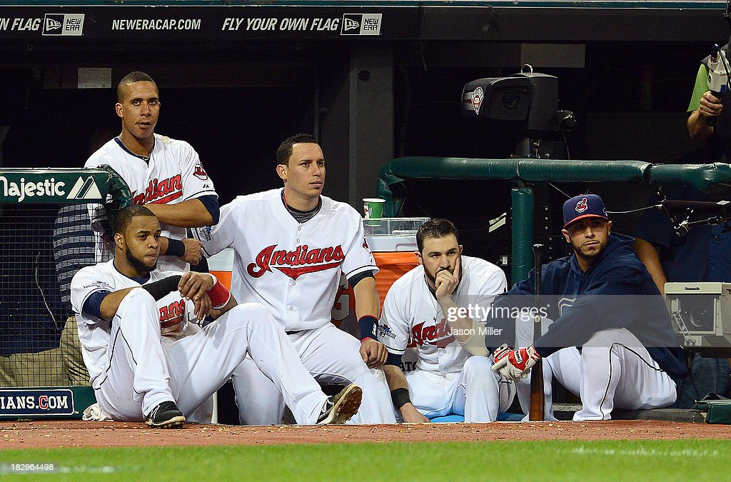 Members of the Cleveland Indians watch the Tampa Bay Rays celebrate after the game at Progressive Field on October 2, 2013 in Cleveland, Ohio.