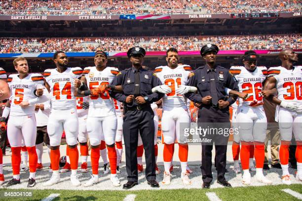 Members of the Cleveland Police join the Cleveland Browns on the sidelines during the National Anthem prior to the game against the Pittsburgh...