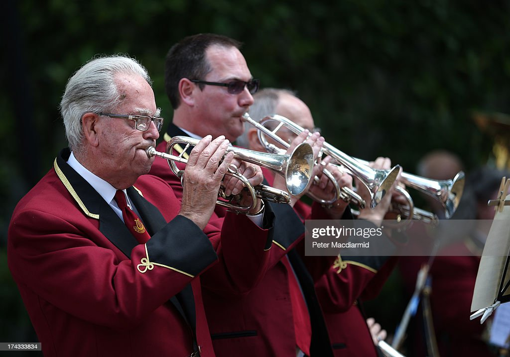 Members of The Cobham Brass Band play in College Garden in the grounds of Westminster Abbey on July 24, 2013 in London, England. A series of lunchtime concerts entitled 'Brass on the Grass' are being held between July 24 and August 28, 2013.
