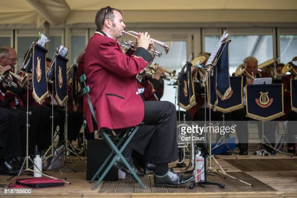 Members of the Cobham Brass Band play in College Garden in the grounds of Westminster Abbey on July 19 2017 in London England A series of lunchtime...