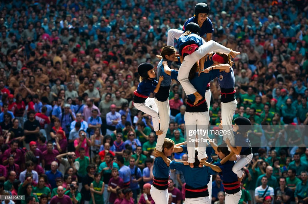 Members of the Colla 'Caprogossos de Mataro' climb up as they construct a human tower during the 24th Tarragona Castells Comptetion on October 7, 2012 in Tarragona, Spain. The 'Castellers' who build the human towers with precise techniques compete in groups, known as 'colles', at local festivals with aim to build the highest and most complex human tower. The Catalan tradition is believed to have originated from human towers built at the end of the 18th century by dance groups and is part of the Catalan culture.