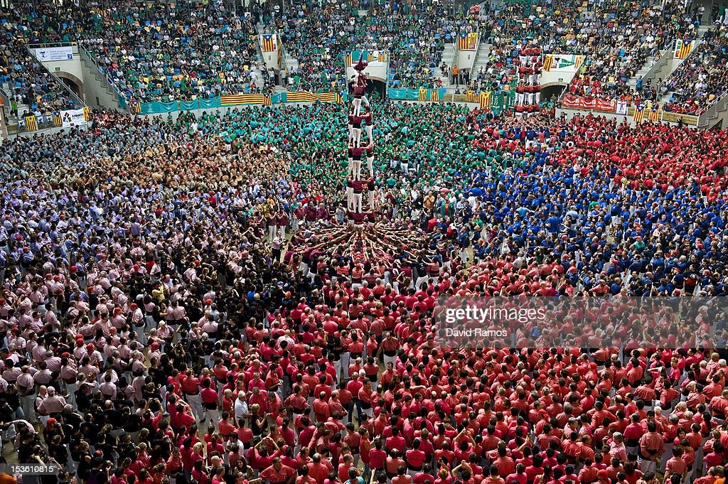Members of the Colla 'Castellers de Lleida' climb up as they construct a human tower during the 24th Tarragona Castells Comptetion on October 7, 2012 in Tarragona, Spain. The 'Castellers' who build the human towers with precise techniques compete in groups, known as 'colles', at local festivals with aim to build the highest and most complex human tower. The Catalan tradition is believed to have originated from human towers built at the end of the 18th century by dance groups and is part of the Catalan culture.