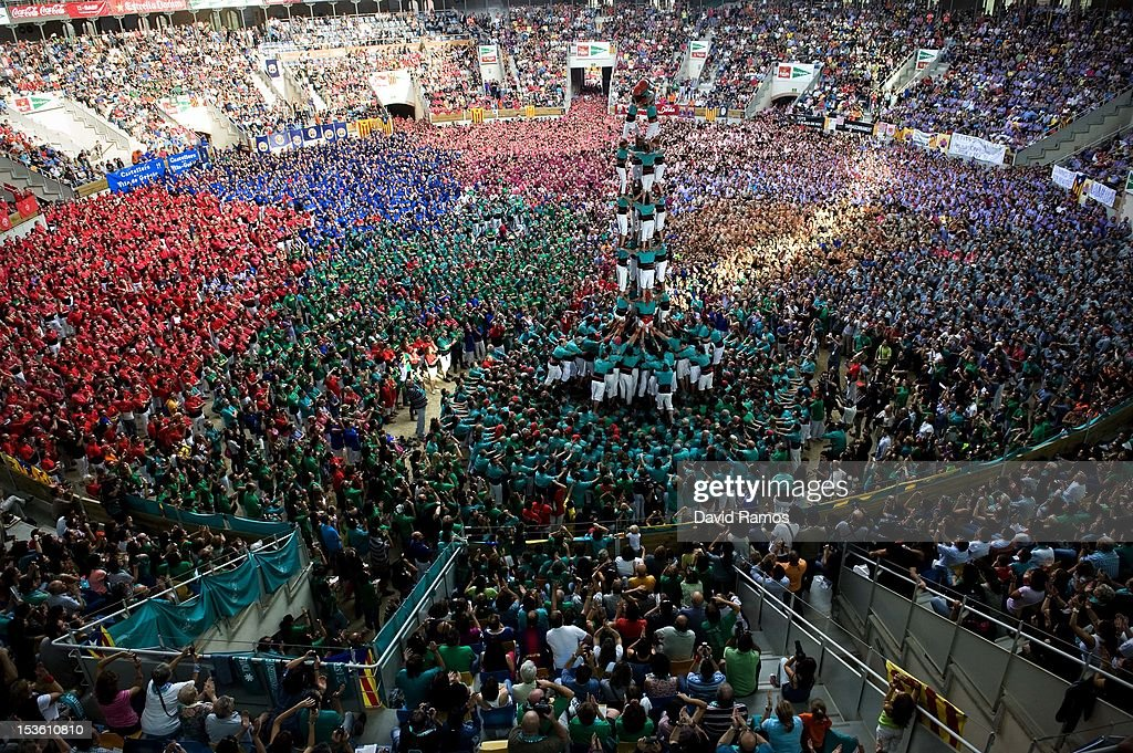Members of the Colla 'Castellers de Vilafranca' climb up as they construct a human tower during the 24th Tarragona Castells Comptetion on October 7, 2012 in Tarragona, Spain. The 'Castellers' who build the human towers with precise techniques compete in groups, known as 'colles', at local festivals with aim to build the highest and most complex human tower. The Catalan tradition is believed to have originated from human towers built at the end of the 18th century by dance groups and is part of the Catalan culture.