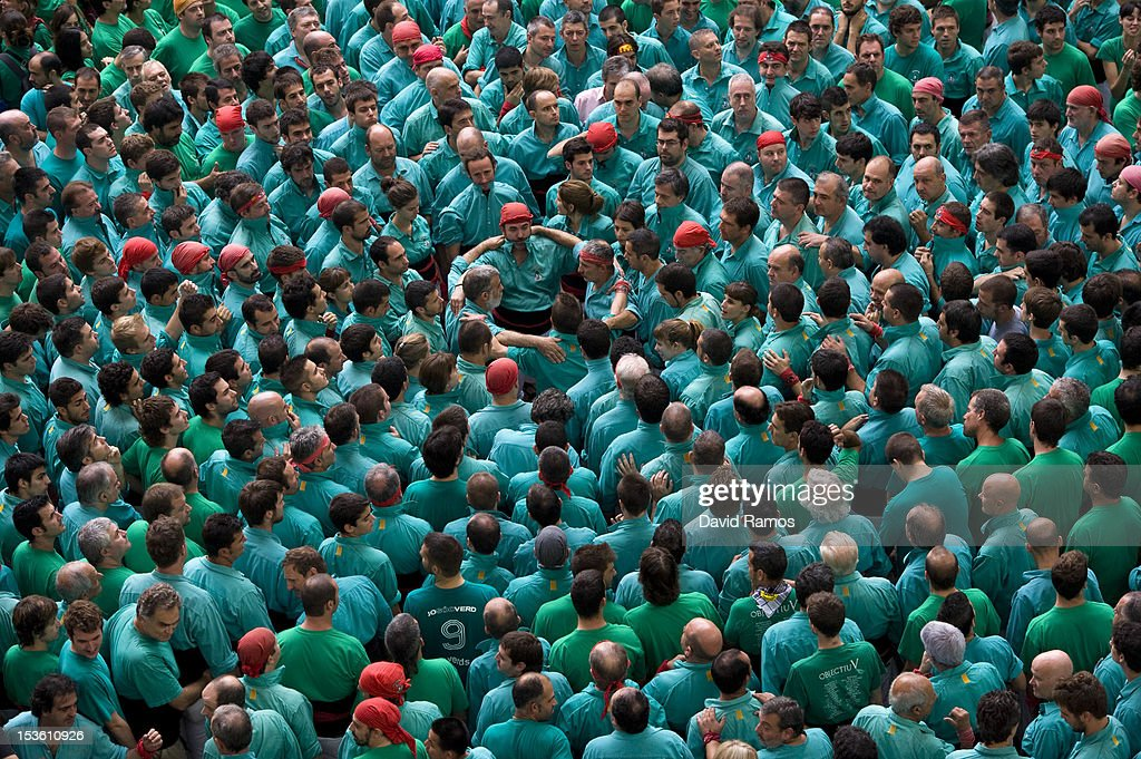 Members of the Colla 'Castellers de Vilafranca' start a construction of a human tower during the 24th Tarragona Castells Comptetion on October 7, 2012 in Tarragona, Spain. The 'Castellers' who build the human towers with precise techniques compete in groups, known as 'colles', at local festivals with aim to build the highest and most complex human tower. The Catalan tradition is believed to have originated from human towers built at the end of the 18th century by dance groups and is part of the Catalan culture.
