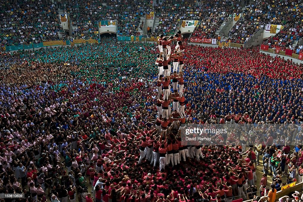 Members of the Colla 'Vella de Valls' climb up as they construct a human tower during the 24th Tarragona Castells Comptetion on October 7, 2012 in Tarragona, Spain. The 'Castellers' who build the human towers with precise techniques compete in groups, known as 'colles', at local festivals with aim to build the highest and most complex human tower. The Catalan tradition is believed to have originated from human towers built at the end of the 18th century by dance groups and is part of the Catalan culture.