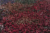 Members of the 'Colla Vella Xiquets de Valls' Human Tower team prepares to a form a 'castell' during the XXV human towers or castells competetion in...
