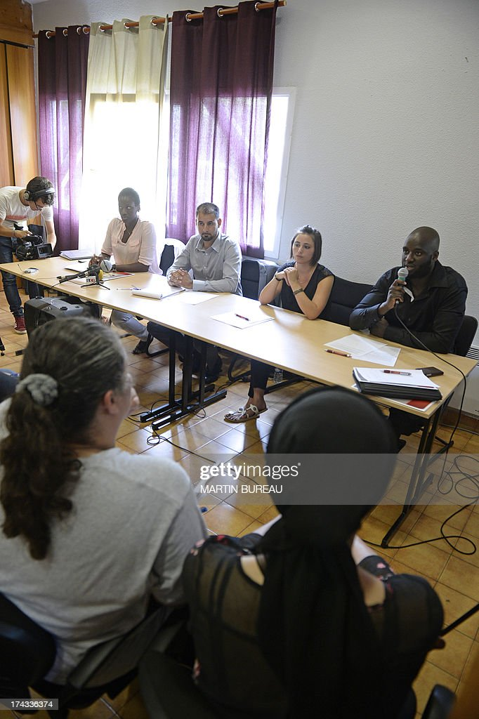 Members of the 'Collectif des Citoyens de Trappes' (Trappes Citizens' association), (From L) Fanta Ba, Mohamed Kamli, Amix Marvaud and Samba Doucoure hold a press conference on July 24, 2013 in the Paris' suburb of Trappes, on the weekend of violence that erupted after a man was detained for allegedly attacking a police officer who had stopped his wife over her full-face veil, a practice that is banned in France, outraging many in the Muslim community. AFP PHOTO / MARTIN BUREAU