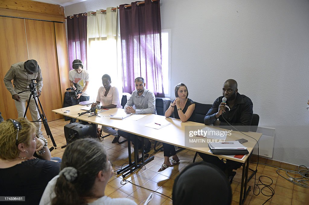 Members of the 'Collectif des Citoyens de Trappes' (Trappes Citizens' association), (From L) Fanta Ba, Mohamed Kamli, Amix Marvaud and Samba Doucoure hold a press conference on July 24, 2013 in the Paris' suburb of Trappes, on the weekend of violence that erupted after a man was detained for allegedly attacking a police officer who had stopped his wife over her full-face veil, a practice that is banned in France, outraging many in the Muslim community.
