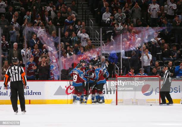 Members of the Colorado Avalanche celebrate a first period goal during a regular season game between the Colorado Avalanche and the visiting St Louis...