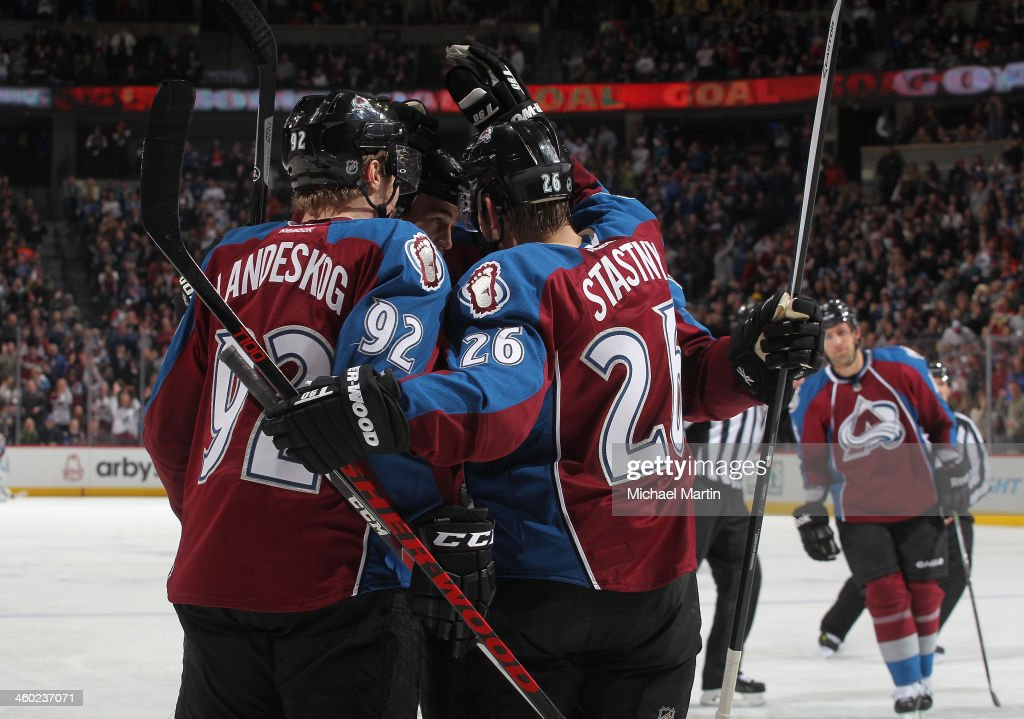 Members of the Colorado Avalanche celebrate a goal against the Philadelphia Flyers at the Pepsi Center on January, 2014 in Denver, Colorado.