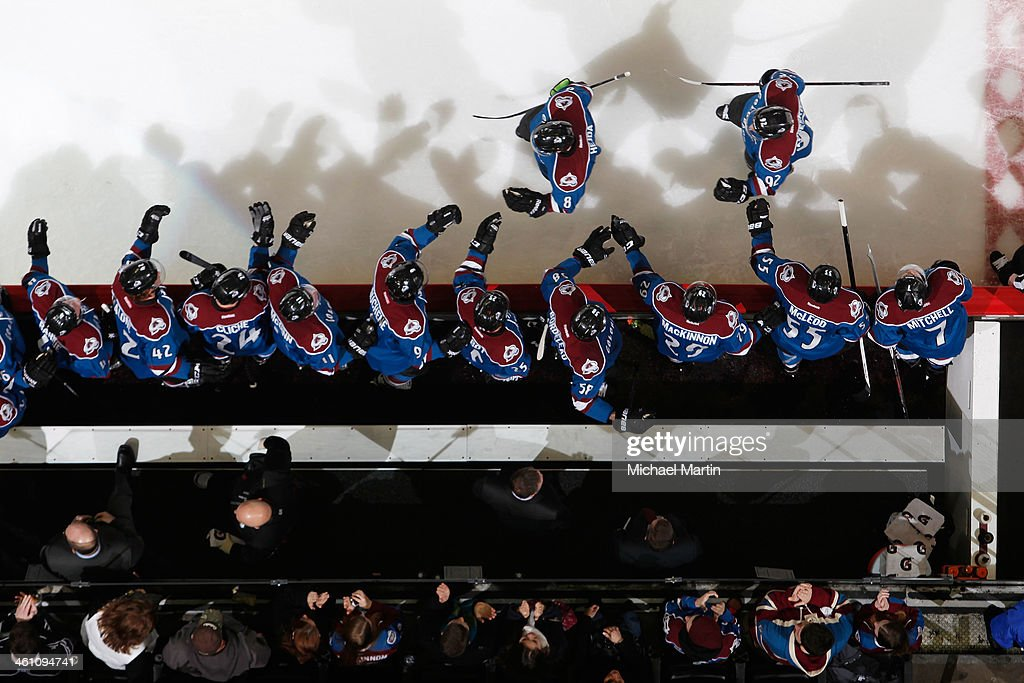 Members of the Colorado Avalanche celebrate a goal against the Calgary Flames at the Pepsi Center on January 06, 2014 in Denver, Colorado. The Flames defeated the Avalanche 4-3.