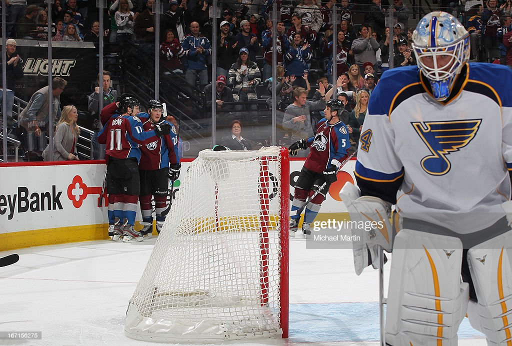 Members of the Colorado Avalanche celebrate a goal as goaltender Jake Allen #34 looks on the St Louis Bluesas at the Pepsi Center on April 21, 2013 in Denver, Colorado. The Avalanche defeated the Blues 5-3.
