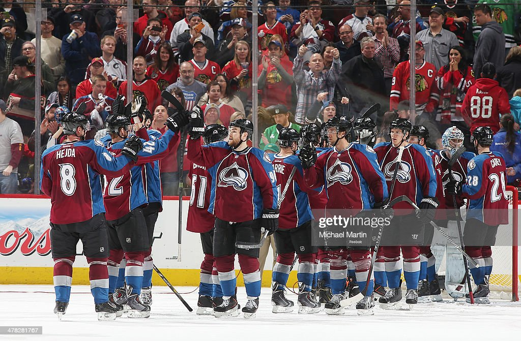 Members of the Colorado Avalanche celebrate a win against the Chicago Blackhawks at the Pepsi Center on March 12, 2014 in Denver, Colorado. The Avalanche defeated the Blackhawks 3-2.