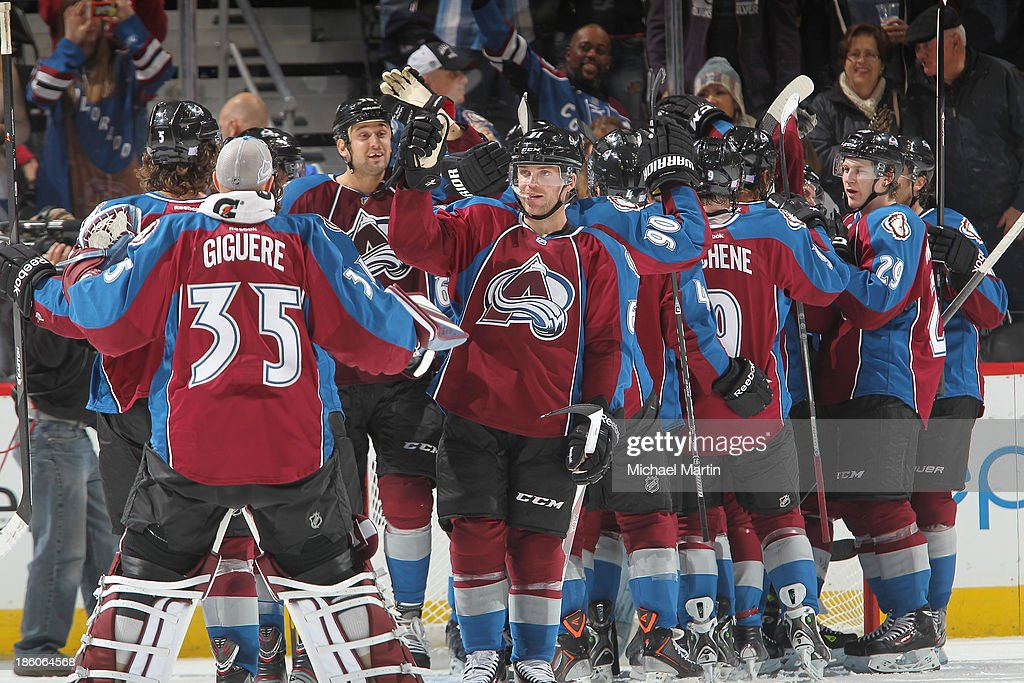Members of the Colorado Avalanche celebrate a win against the Winnipeg Jets at the Pepsi Center on October 27, 2013 in Denver, Colorado. The Avalanche defeated the Jets 3-2.