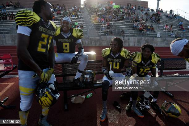 Members of the Colorado Greyhawks defensive unit joke around on the sidelines after intercepting a pass by the NoCo Nightmare during the second...