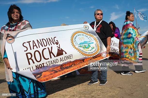 Members of the Colorado River Tribes hold a banner to show their support for Native Americans of the Standing Rock reservation who oppose the...