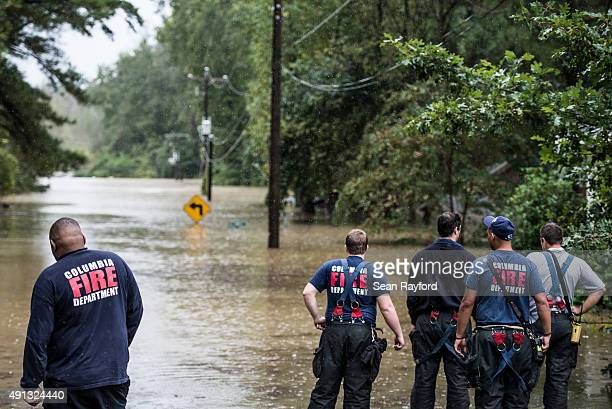 Members of the Columbia Fire Department look out over the flooding on Tall Pines Circle October 4 2015 in Columbia South Carolina South Carolina...
