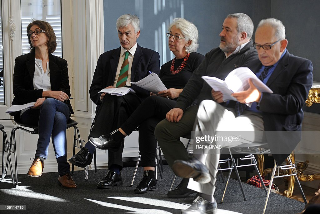 Members of the comission for a peace process boost, Maite Perez (L), Nazario Oleaga (2L), Anne Marie Bordes (C), Fernando Armendariz (2R) and Henri Duhalt (R) attend a press conference in San Sebastian on December 23, 2013 organised by Basque nationalist associations Bake Bidea and Lokarri to announce the creation of a civil commission to 'boost the peace process', amid persistent rumors of an upcoming deposition of weapons by the separatist group ETA. 'The commission will be responsible for managing a series of recommendations such as disarmament (...) the dismantling of ETA's military structures, rehabilitation of prisoners (...) with the institutions, political parties and actors involved in the peace process ', stated the two associations.