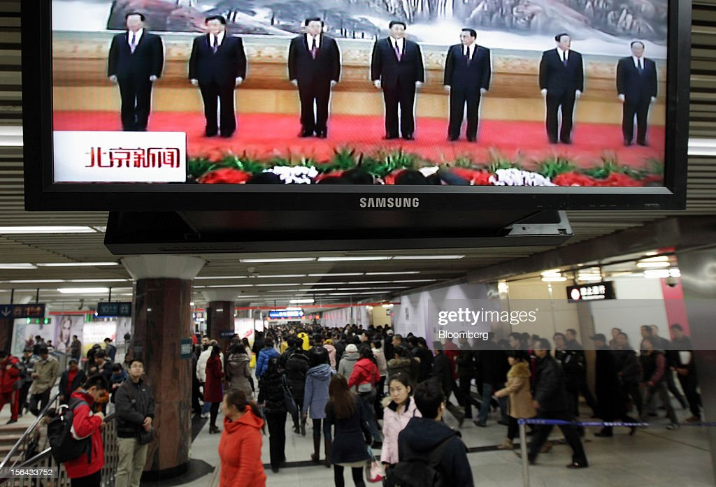 Members of the Communist Party of China's new Politburo Standing Committee are seen standing during a news broadcast, displayed on a television monitor at a subway station in Beijing, China, on Thursday, Nov. 15, 2012. Xi Jinping replaced Hu Jintao as head of the Chinese Communist Party and the nation's military, ushering in the fifth generation of leaders who are set to run the world's second-biggest economy over the next decade. Photographer: Tomohiro Ohsumi/Bloomberg via Getty Images
