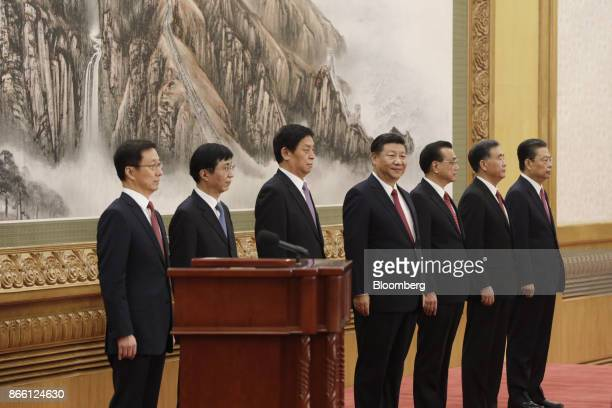 Members of the Communist Party of China's new Politburo Standing Committee Han Zheng from left Wang Huning Li Zhanshu Xi Jinping China's president Li...