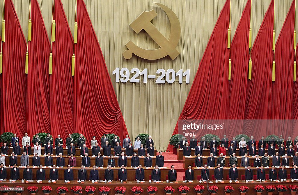 Members of the Communist Party stand and sing the song International during the celebration of the Communist Party's 90th anniversary at the Great Hall of the People on July 1, 2011 in Beijing, China.