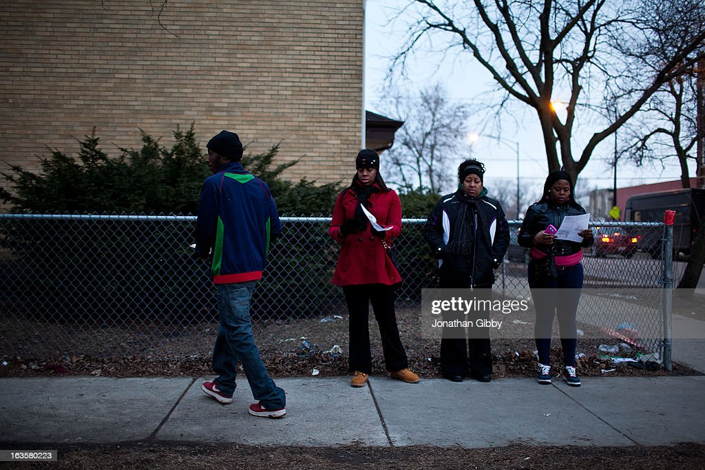 Members of the community distribute flyers encouraging individuals to come forward with information regarding the killing of Jonylah Watkins on March 12, 2013 in Chicago, Illinois. The 6-month-old girl was shot five times on the 6500 block of South Maryland Avenue while her father was changing her diaper in the passenger seat of his car. The father, Jonathan Watkins remains is stable condition at Nothwestern Memorial Hospital after receiving three gunshot wounds.