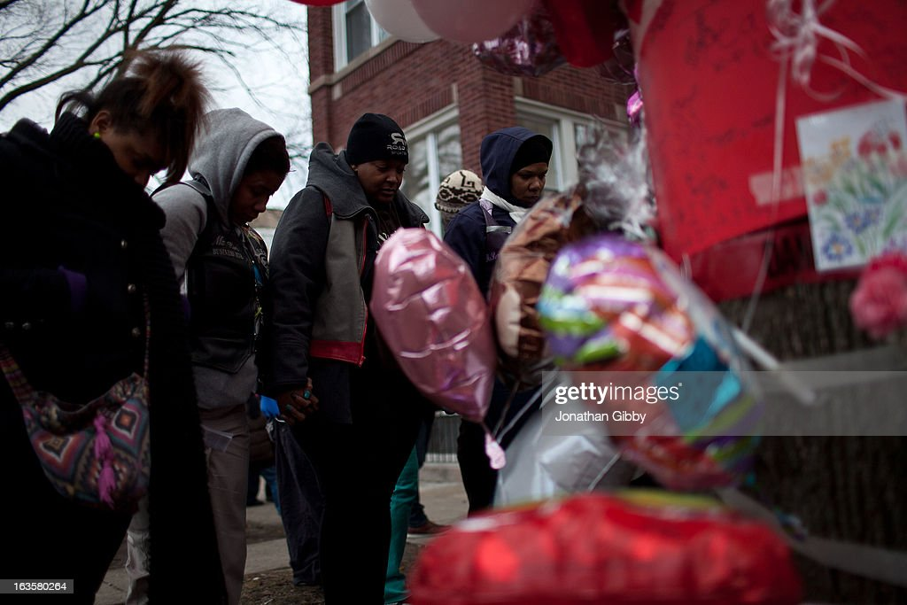 Members of the community gather during a vigil for slain infant Jonylah Watkins on March 12, 2013 in Chicago, Illinois. The 6-month-old girl was shot five times on the 6500 block of South Maryland Avenue while her father was changing her diaper in the passenger seat of his car. The father, Jonathan Watkins remains is stable condition at Nothwestern Memorial Hospital after receiving three gunshot wounds.