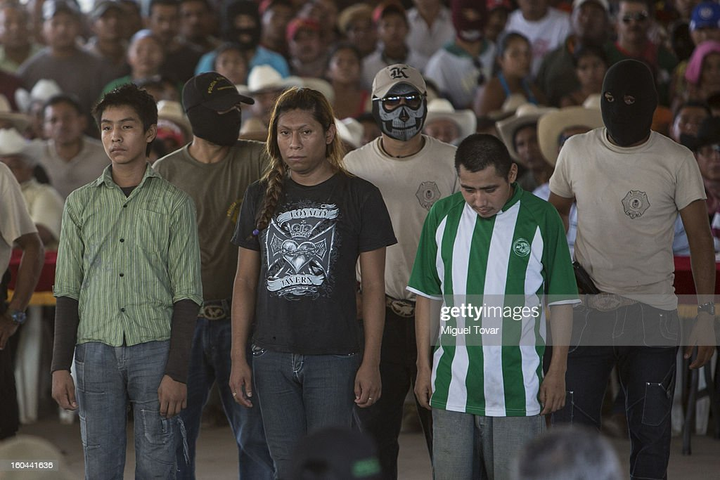 Members of the community of Ayutla escort kidnapping suspects and members of local criminal gangs on January 30, 2013 in Ayutla Guerrero, Mexico. Hundreds of men have taken up arms in several towns of the southern state of Guerrero to defend their communities against violent criminal gangs.