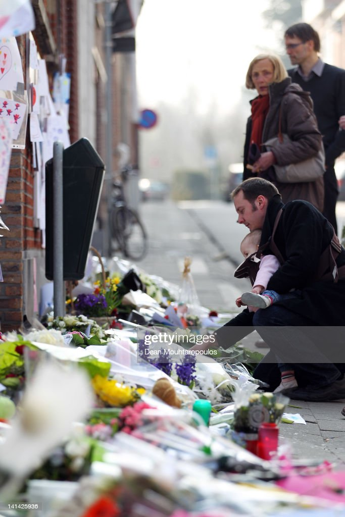 Members of the community pay their respects with flowers, toys, candles and messages of love and support at the wall of Saint Lambertus School during a national day of mourning on March 16, 2012 in Heverlee, Belgium. Belgium held a national day of mourning to remember all those who died in a coach crash earlier this week. The accident occurred when a school bus carrying 11 -12 year olds, returning from a skiing holiday, crashed into a tunnel wall, killing 28 of the 52 passengers.
