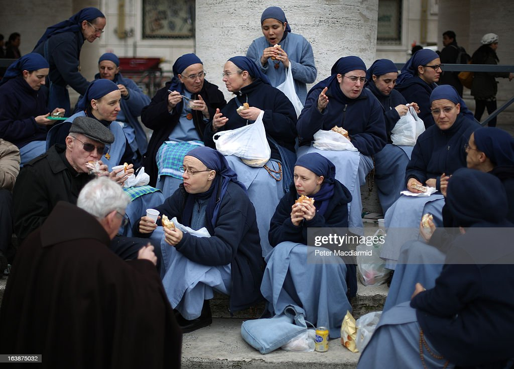 Members of the Communtity of the Little Sisters of the Lamb enjoy lunch in St Peter's Square after Pope Francis gave his first Angelus blessing on March 17, 2013 in Vatican City, Vatican. The Vatican is preparing for the inauguration of Pope Francis on March 19, 2013 in St Peter's Square.
