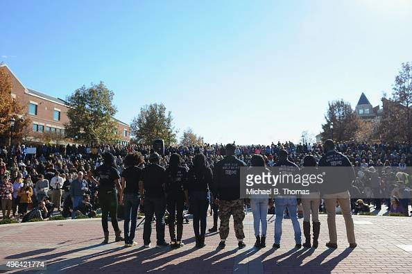 Members of the Concerned Student 1950 movement speak to the crowd of students on the campus of University of Missouri Columbia on November 9 2015 in...