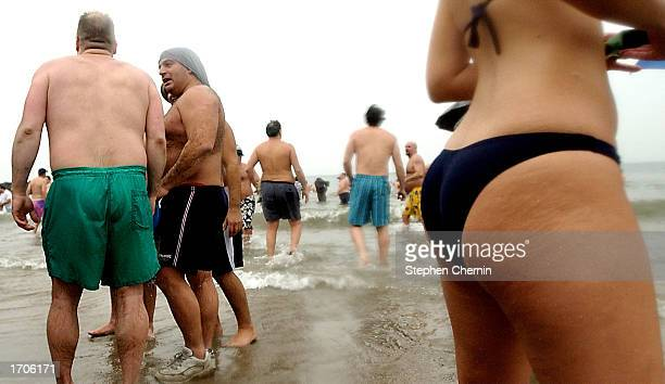 Members of the Coney Island Polar Bears Swim Club stand at the waters edge after about 100 members took their annual dip in the Atlantic Ocean off...