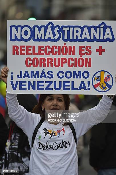 Members of the Confederation of Indigenous Nationalities of Ecuador and opposition organizations hold a protest in Quito on November 26 2015 against...
