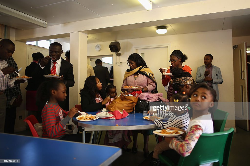 Members of the congregation enjoy a meal after a 'Seventh Day Evangelist' service at Crossway Church in the Heygate Estate on April 27, 2013 in London, England. The Crossway Church is an international church, with the congregation made up of native Londoners as well as people from Ghana, Jamaica, South Africa, Zimbabwe, Korea, Brazil, Eastern Europe and the United States. It has been serving the local community at different sites around Elephant and Castle for almost 150 years. The church has been at it's current location in the Heygate estate since 1974. The Heygate estate in central London was built in 1974 as social housing and housed around 3000 people, but fell into a state of disrepair, gaining a reputation for crime and poverty. The estate is due to be demolished as part of the £1.5billion GBP 'Elephant & Castle regeneration scheme', and replaced with 2,500 affordable new homes. The area has become popular with street artists, storytellers, and guerilla gardeners and attracts an array of urban wildlife including bats, birds and mammals.