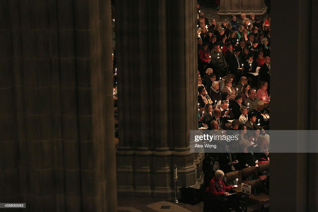 Members of the congregation hold candles during the National Vigil for Victims of Gun Violence December 12, 2013 at the Washington National Cathedral in Washington, DC. The event was to mark the one year anniversary of the December 14, 2012 shooting that killed 26 students and teachers at Sandy Hook Elementary School in Newtown, Connecticut.