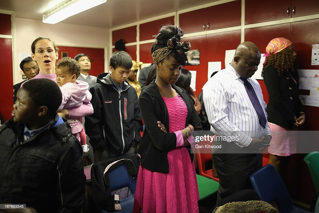 Members of the congregation prey during a 'Seventh Day Evangelist' service at Crossway Church in the Heygate Estate on April 27, 2013 in London, England. The Crossway Church is an international church, with the congregation made up of native Londoners as well as people from Ghana, Jamaica, South Africa, Zimbabwe, Korea, Brazil, Eastern Europe and the United States. It has been serving the local community at different sites around Elephant and Castle for almost 150 years. The church has been at it's current location in the Heygate estate since 1974. The Heygate estate in central London was built in 1974 as social housing and housed around 3000 people, but fell into a state of disrepair, gaining a reputation for crime and poverty. The estate is due to be demolished as part of the £1.5billion GBP 'Elephant & Castle regeneration scheme', and replaced with 2,500 'affordable' new homes. The area has become popular with street artists, storytellers, and guerilla gardeners and attracts an array of urban wildlife including bats, birds and mammals.