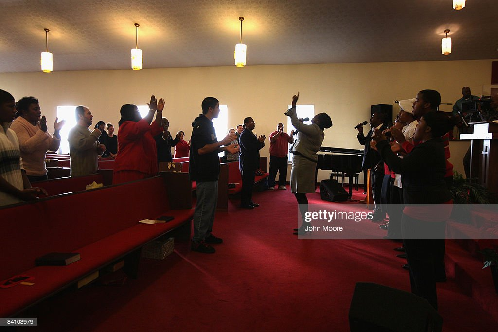 Members of the congregation sing during a Sunday service at the Bible Missionary Baptist Church December 21 2008 in Wilmington Ohio Reverend Kurtis...