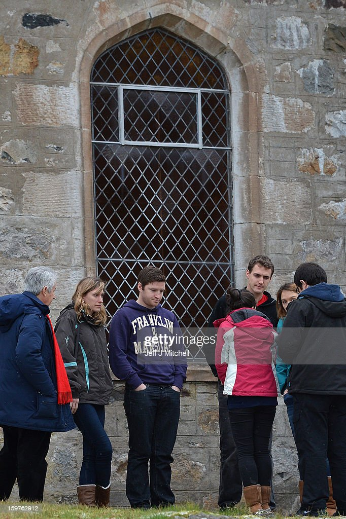 Members of the congregation stand outside St Munda's Church, following prayers being offered for the people affected by an avalanche that killed four climbers and left a fifth with head injuries on January 20, 2013 in Glencoe, United Kingdom. A party of six, three men and three women were descending Bidean Nam Bian close to Church Door Buttress when the snow slope broke away.