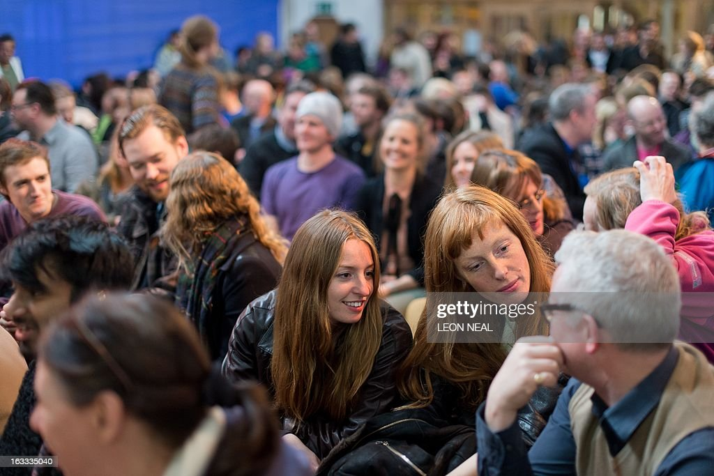 Members of the congregation talk among themselves during The Sunday Assembly an atheist service held at a converted church in north London on March 3...