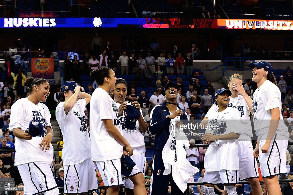 Members of the Connecticut Huskies celebrate a victory over the Louisville Cardinals following the National Final game of the 2013 NCAA Division I Women's Basketball Championship at New Orleans Arena on April 9, 2013 in New Orleans, Louisiana.