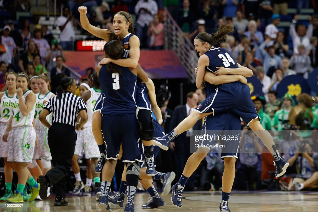 Members of the Connecticut Huskies celebrate after defeating the Notre Dame Fighting Irish 83-65 during the National Semifinal game of the 2013 NCAA Division I Women's Basketball Championship at the New Orleans Arena on April 7, 2013 in New Orleans, Louisiana.
