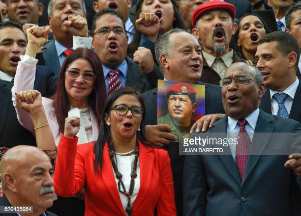 Members of the Constituent Assembly Cilia Flores Delcy Rodriguez Diosdado Cabello and Aristobulo Isturiz pose with a picture of late Venezuelan...