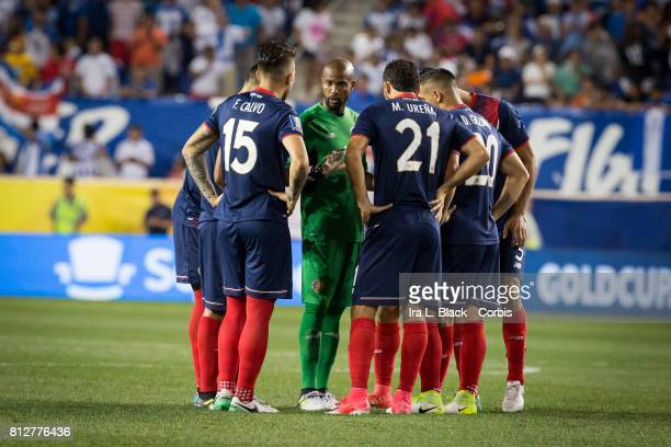Members of the Costa Rica team huddle at the start of the Group A CONCACAF Gold Cup Match between Honduras and Costa Rica at the Red Bull Arena on...