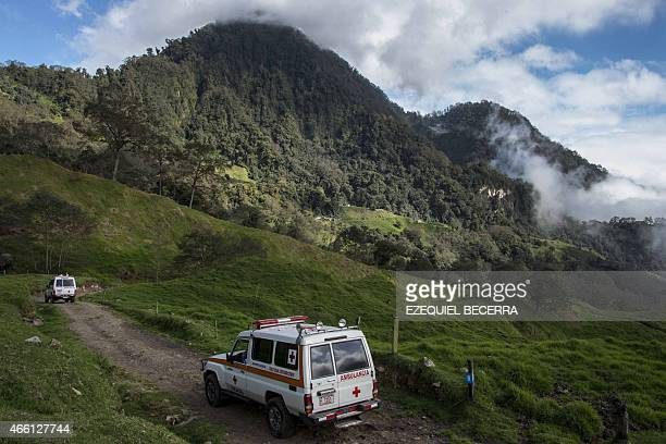 Members of the Costa Rican Red Cross patrol the area surrounding the Turrialba volcano checking the quality of the air in San Gerardo de Irazu 65 km...