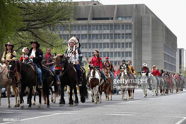 Members of the Cowboy and Indian Alliance including Native Americans farmers and ranchers from across the United States ride horseback down...
