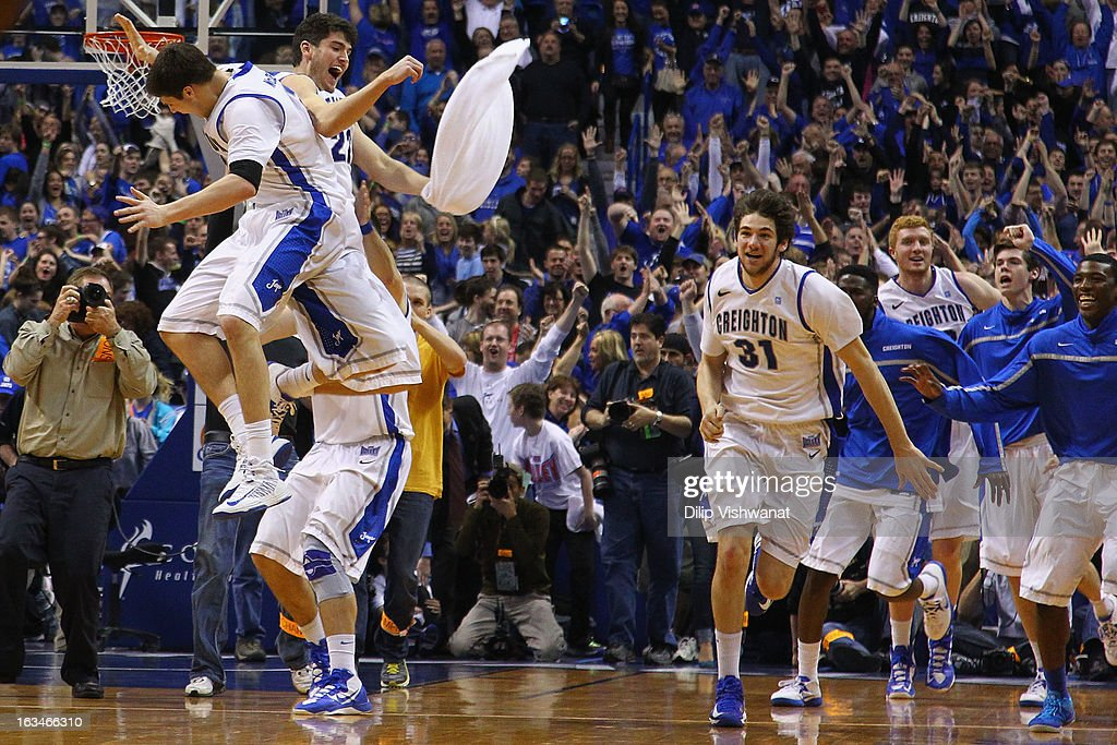 Members of the Creighton Bluejays celebrate beating the Wichita State Shockers for the championship of the Missouri Valley Conference Tournament at...